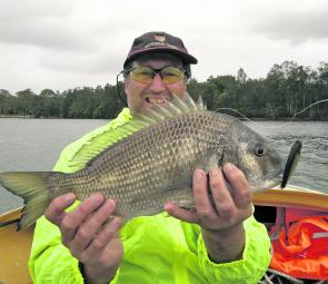 Steve Davidson with a solid bream that took a lure. Fish like these should be chasing prawns this month.
