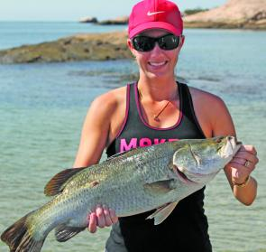 Alison Kaggelis with an average Bowen fat 65cm barra. Fish around this size and condition will be abundant in February.