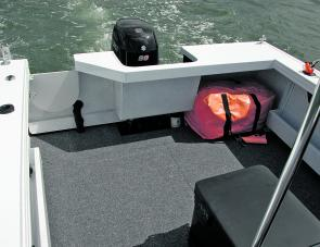 The Procraft's locking cockpit door will allow a swimmer to enter, which is a handy feature for family boaters.