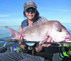 Tornz with a lovely Port Phillip snapper that she caught on a light spin outfit.