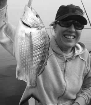 Debbie with a solid bream caught just off the runway.