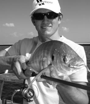 Tim with a solid trevally taken on a Squidgy Flick Bait just of the third runway late in the afternoon.