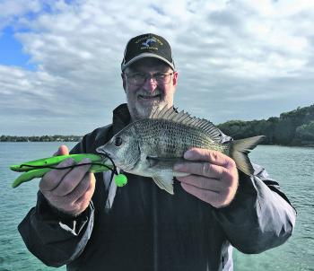 Dave Marler with a rock wall bream caught on a plastic.