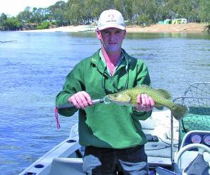 Bendigo's Derek Blow displays a feisty little greenfish taken downstream from Cobram.