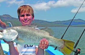 Young Bo Michael with his first barra at 66cm.