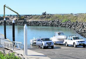 The Coffs Harbour boat ramp in a benign mood, with the excavator clearing the sand away. $60,000 well spent?