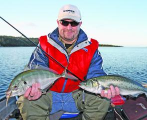 Jordan Fidian with an Australian salmon and a lovely silver trevally.