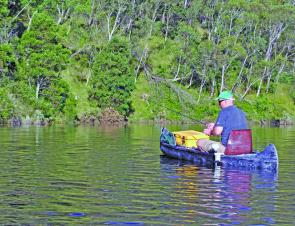 Searching new backwaters in a canoe is perhaps the best way to fish the reclaimed land in the many bays and arms of Lake Lyell.