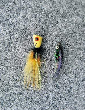 Poppers like the yellow one shown are very handy at first light but must be worked very gently. The author's rough and ready Vampire is another wet fly that works on stream bass.