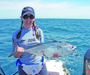 Photo Diana Campbell with a Mack Tuna taken on a trolled Garfish.
