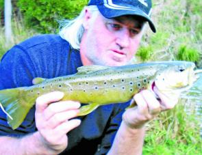 Clive Rendell shows off this lovely brown trout measuring 43cm caught on a Berkley soft plastic.