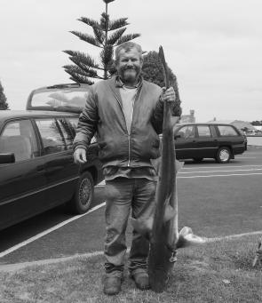 Mick Sheehan with another victim from the Lee Breakwall – a 15kg gummy shark.