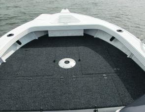 Neatly finished carpet work, plenty of storage and abundant room on the casting deck are top features of the Clark Dominator 510. Note the large anchor well.