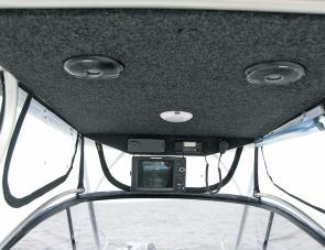 Best use of the clean space under the hard top saw the big Humminbird unit as well as marine and pleasure radios set up out of the way.