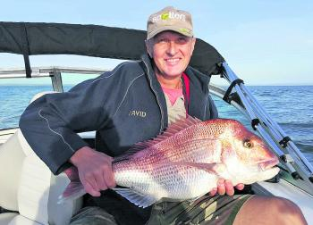 David Goldsworthy and his great snapper caught in the Bouchier Channel.