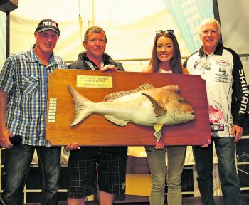 Chloe Taylor lifting the Dave Irvine Memorial Snapper Classic Champion Angler Trophy.