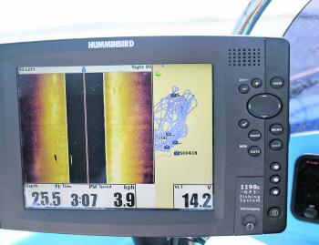 A combination of side image and GPS is deadly in open water. The sounder has scanned a fish on the left side of the boat. The bright line is the barra and you can see its shadow to the left of its return.