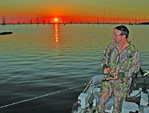 Sandy Hector fishing a surface popper at Lake Mulwala on sunset.