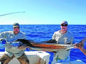 Ben Durkin and Tim Mullhall show off an impressive sailfish.