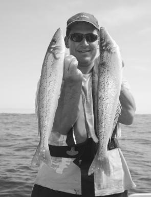 Andrew Mayne shows off a pair of big King George whiting taken from the Golf Course Reef.