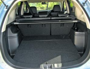 A large rear cargo area remains a big selling point with the hybrid Outlander. Note the cargo blind up top.