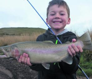 Zach Stevens chips in with a great rainbow trout from Lake Learmonth.