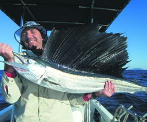 Shannon and the first sailfish in the boat. The smile says it all.