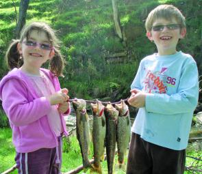 Ben and Chloe Cornford with a few brown trout caught in South Gippsland at the opening of the trout season.