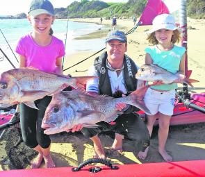 Randall Gibbs needed help from Jasmin and Tiarn to help hold this healthy catch of snapper.