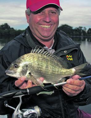 Wayne Bale with a bream caught fishing soft plastics deep late in the day.