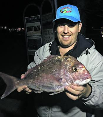 Dan Le Mar with a great eating-size snapper caught at Fidos Reef.