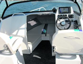 Thoughtful touches count: additional grab handles behind seats are handy in an offshore craft.