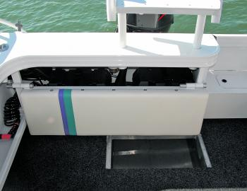 Shelving keeps important electrical and fuel components away from water, with the craft's deck wash and drop down seat an important feature of the fishing components.