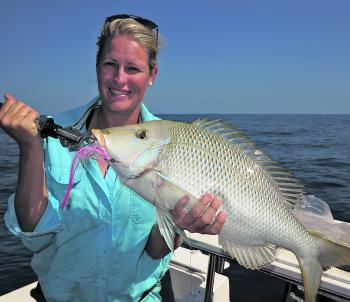Cassee Evans with a spangled emperor taken on a trip with Extreme Fishing Solutions.