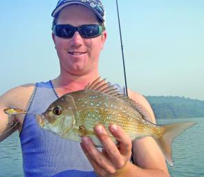 John with a 41cm pinkie caught on a vibration lure.