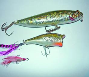 Recommended surface lures for chasing barra, the tango dancer (top) and with the modified Surecatch popper (middle) and the original light tail treble (bottom) for comparison.