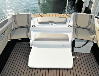 The inboard cover space isn't wasted with a fold-down table and cup holders incorporated into the design.