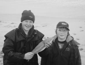 James and Harry with James' first ever salmon.