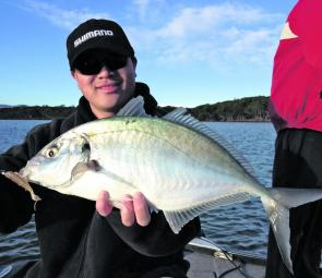 Alex Nguyen with a hard fighting silver trevally caught on a Squidgy Wriggler.