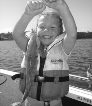 The author's daughter Jessica, 4, with her trevally caught on a soft plastic.