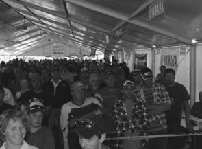 Competitors pack into the tent for the presentations.