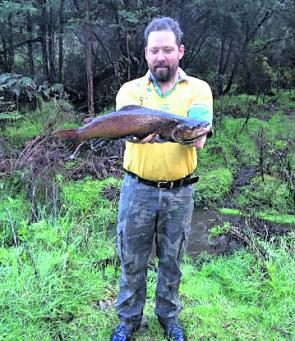 Les with a 62cm brown trout caught and released just before the season closed on the Queen's Birthday weekend in June.