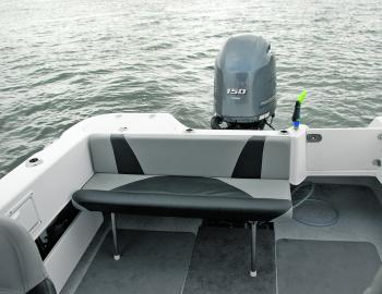 A collapsible rear seat makes a lot of sense in a fishing boat. When folded down for serious work the back rest makes a handy bolster as well.