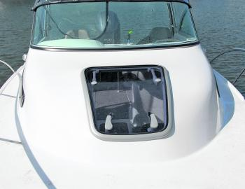 Although a power winch is an option, standard anchor well access is via the Baysports' large cabin hatch.