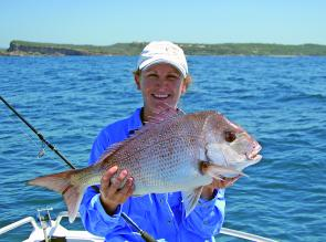 Danielle Carson with a lovely snapper caught off Bonny Hills on a soft plastic.