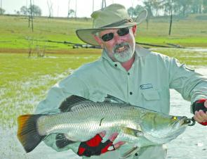 Tony Baylis with his barra that was caught in 31 water.