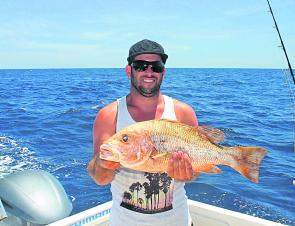 Andrew holding a great golden snapper (fingermark) caught on live bait.