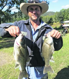 Michael Hartin shows off some quality Cressbrook bass, which were caught in deep water using shrimp suspended below the boat.