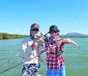 Quality flathead like this pair can be found in all Mackay creeks and estuaries during November.
