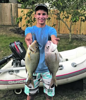 Jordan Zappala with an awesome bay double of a sweetlip and snapper caught just a few metres offshore from Amity Point.